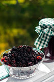 Fresh blackberries and a jar of jam Stock Image