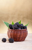 Fresh blackberries in small basket Stock Photo