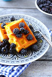 Fresh blackberries and waffles Royalty Free Stock Photos