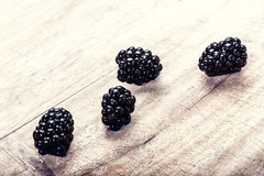 Fresh  Blackberries on wooden background Stock Photography