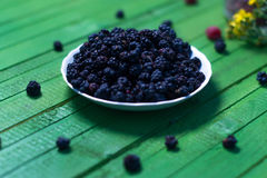 Fresh blackberries on a wooden green background. Royalty Free Stock Photo