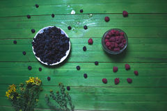 Fresh blackberries on a wooden green background. Stock Photography
