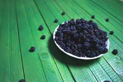 Fresh blackberries on a wooden green background. Royalty Free Stock Images