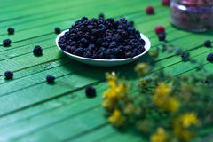 Fresh blackberries on a wooden green background. Stock Photo
