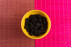 Fresh blackberries in a yellow bowl Stock Image