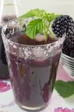 Fresh blackberry juice decorated with blackberry, sugar and blac Royalty Free Stock Images