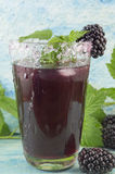 Fresh blackberry juice decorated with blackberry, sugar and blac Royalty Free Stock Photography