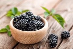 Fresh blackberry with leaves on wooden background Royalty Free Stock Photo
