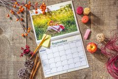 Fresh blank calendar open to September month, sticky note and pe Royalty Free Stock Images
