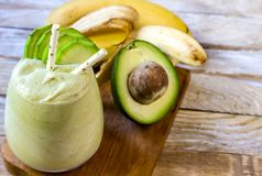 Fresh blended Banana and avocado smoothie. With yogurt or milk in glasses, healthy eating, superfood stock photography