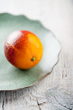 Fresh blood orange on the plate Stock Photography