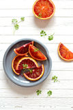 Fresh blood oranges in a vintage plate Royalty Free Stock Photos