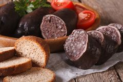 Fresh blood sausages and vegetables on a plate close-up. horizon Stock Image