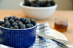 Fresh Bluberries And Table Setting Royalty Free Stock Photos