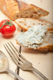 Fresh blue cheese spread ove french baguette Stock Photo