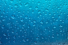 Fresh blue drops of water. Close up of fresh blue drops of water royalty free stock images