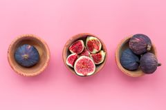 Fresh blue figs in bowls on pink background top view copyspace Royalty Free Stock Photo