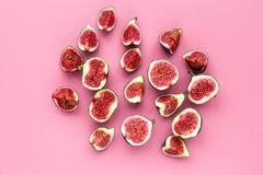 Fresh blue figs slices on pink background top view copyspace Stock Photo