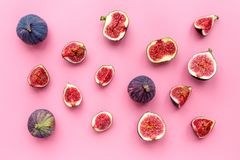 Fresh blue figs whole and slices on pink background top view copyspace Stock Images