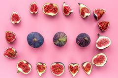 Fresh blue figs whole and slices on pink background top view copyspace Royalty Free Stock Photo