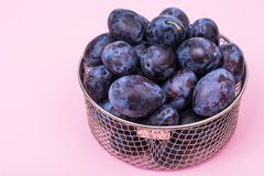 Fresh blue plums on bright background Royalty Free Stock Images