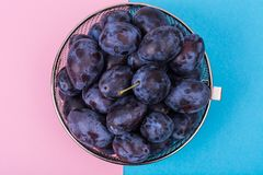 Fresh blue plums on bright background Royalty Free Stock Image