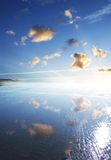 Fresh Blue Sky. A open blue sky reflected on a water covered beach stock photography