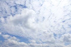Fresh blue sky and fluffy cloud background Stock Images