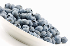 Fresh blueberries. Isolated on plate Stock Photography