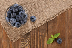 Fresh blueberries on a background of burlap  planks Stock Photos
