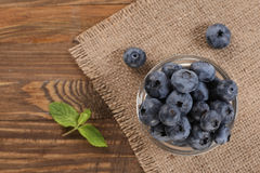 Fresh blueberries on a background of burlap Stock Photos