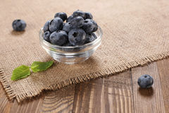 Fresh blueberries on a background of burlap Stock Photography