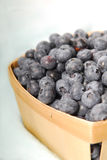 Fresh blueberries in a basket Royalty Free Stock Images