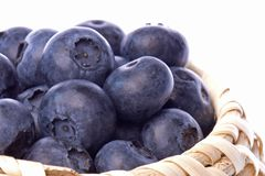 Fresh blueberries in basket Stock Images