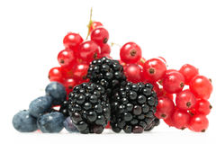 Fresh blueberries, blackberries and redcurrants. Close-up of fresh and nutritious berries as blueberries, blackberries and redcurrants, natural source of Vitamin Stock Photo