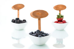 Fresh blueberries, Blackberry, strawberry with signboard in bowl Royalty Free Stock Images