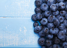 Fresh blueberries. On the blue colored wooden table Royalty Free Stock Photos
