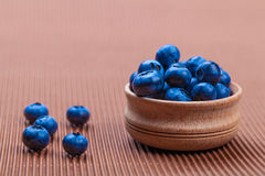 Fresh blueberries in bowl. On a brown background Stock Photo