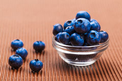 Fresh blueberries in bowl. On a brown background Royalty Free Stock Photos
