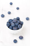 Fresh blueberries in a bowl, vertical, top view Royalty Free Stock Images