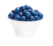 Fresh blueberries in a bowl. On white background Royalty Free Stock Image