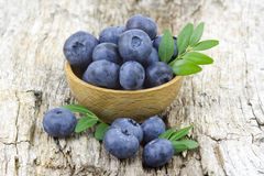 Fresh blueberries in a bowl. On wooden background Stock Photography