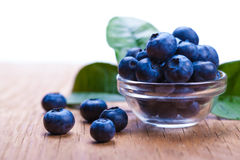 Fresh blueberries in a bowl. On wooden background Royalty Free Stock Photos