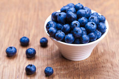 Fresh blueberries in a bowl. On wooden background Stock Photo