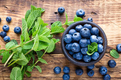 Fresh blueberries in bowl. On wooden table Royalty Free Stock Image