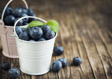 Fresh Blueberries in bucket. On wooden background Royalty Free Stock Photo