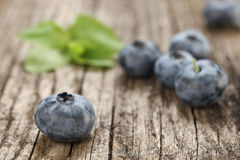 Fresh blueberries close up on a background of wooden planks Royalty Free Stock Photos