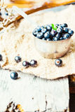 Fresh blueberries, currants and gooseberries in the metallic pla. Tes, autumn rustic background Stock Photo