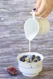 Fresh blueberries and figs corn flakes with milk Royalty Free Stock Images