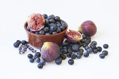 Fresh blueberries and figs in pottery Royalty Free Stock Images